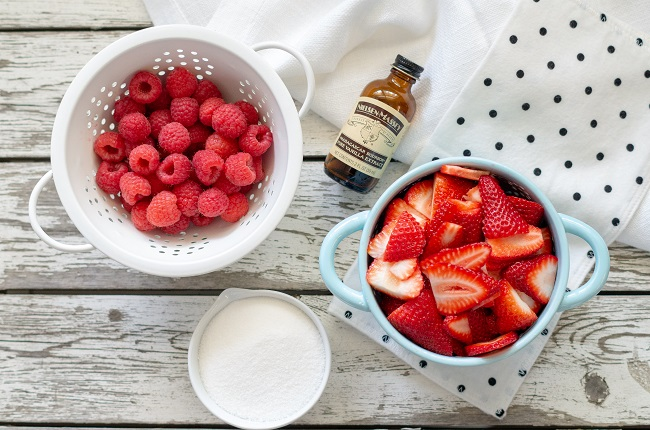 Ingredients for Berry Sauce Recipe. Strawberries, raspberries, sugar and vanilla extract.