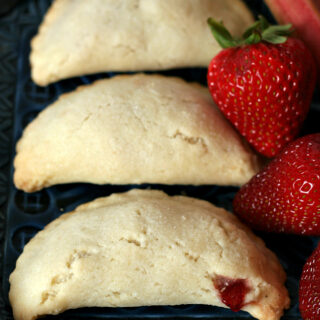 Gluten-free Strawberry Rhubarb Hand Pies. Recipe for a fun portable treat!