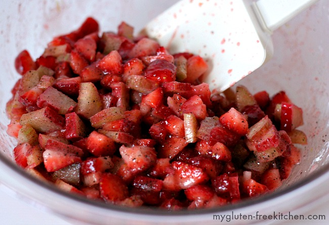 Bowl with strawberry rhubarb mixture for gluten-free hand pies