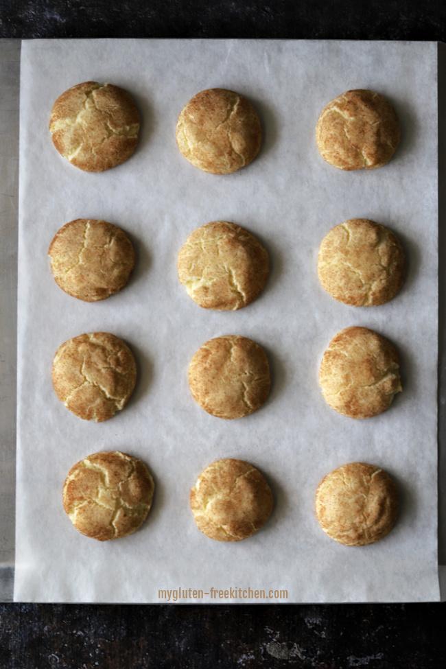 Baked gluten-free snickerdoodles on cookie sheet