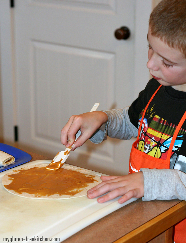 Making peanut butter tortilla roll ups