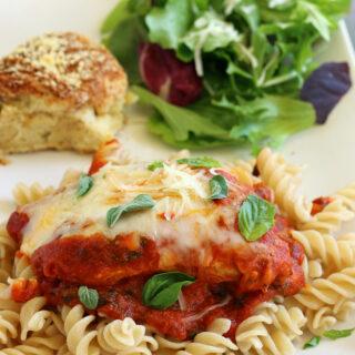 Gluten-free Skillet Chicken Parmesan with salad and gluten-free roll