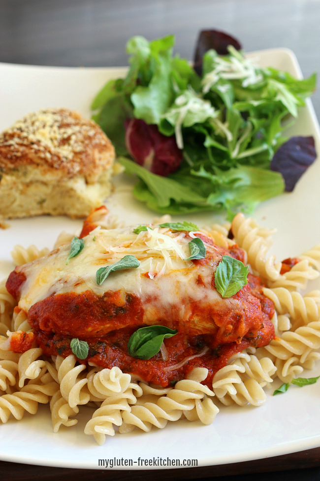 Gluten-free Skillet Chicken Parmesan with salad and gluten-free roll