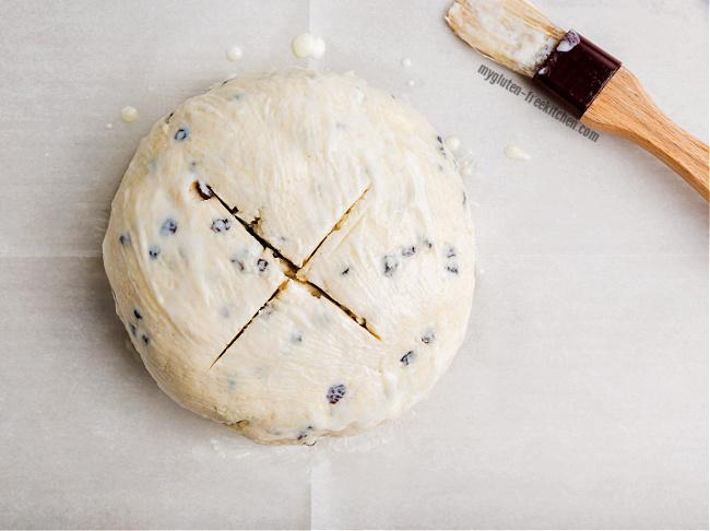 unbaked gluten-free Irish soda bread with a cross cut into it