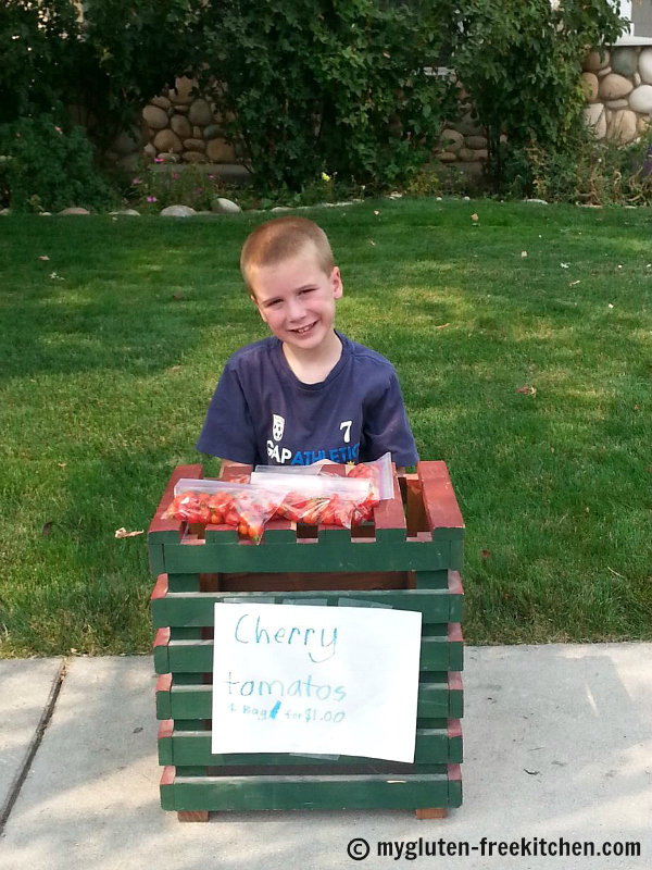 Gardenign with kids: My son selling cherry tomatoes that he grew and harvested!