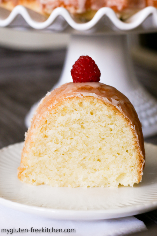 Slice of gluten-free lemon coconut cake with a raspberry
