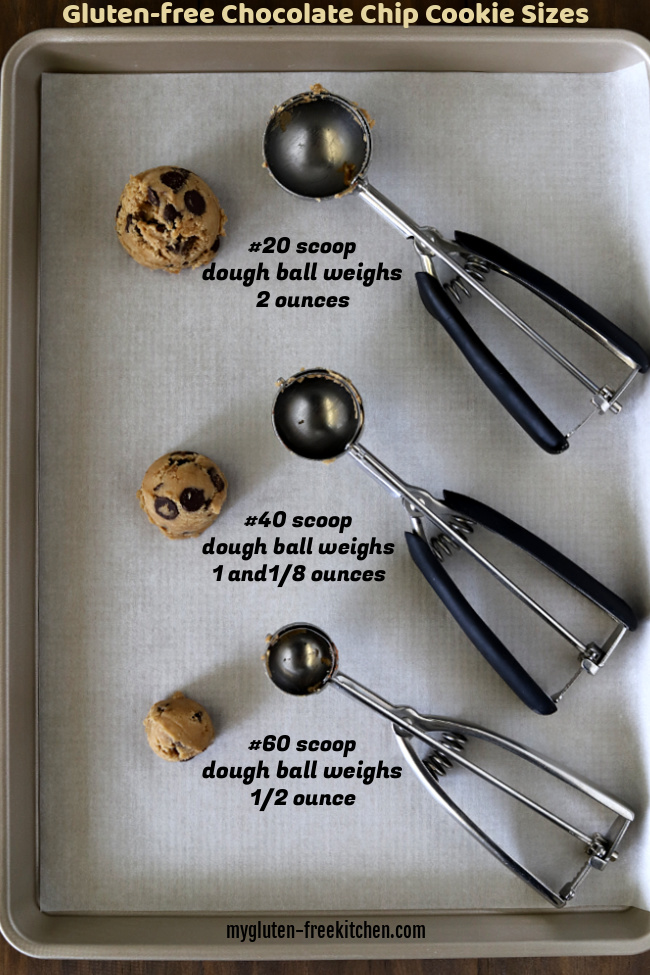 Cookie sheet with three sizes of cookie dough balls and scoops