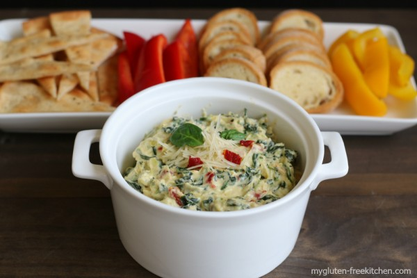 Artichoke Spinach Dip with gluten-free baguette slices and pizza wedges