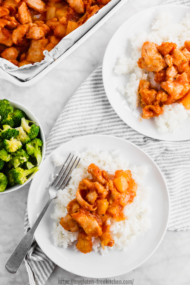 Serving gluten-free sweet and sour chicken on plates with rice