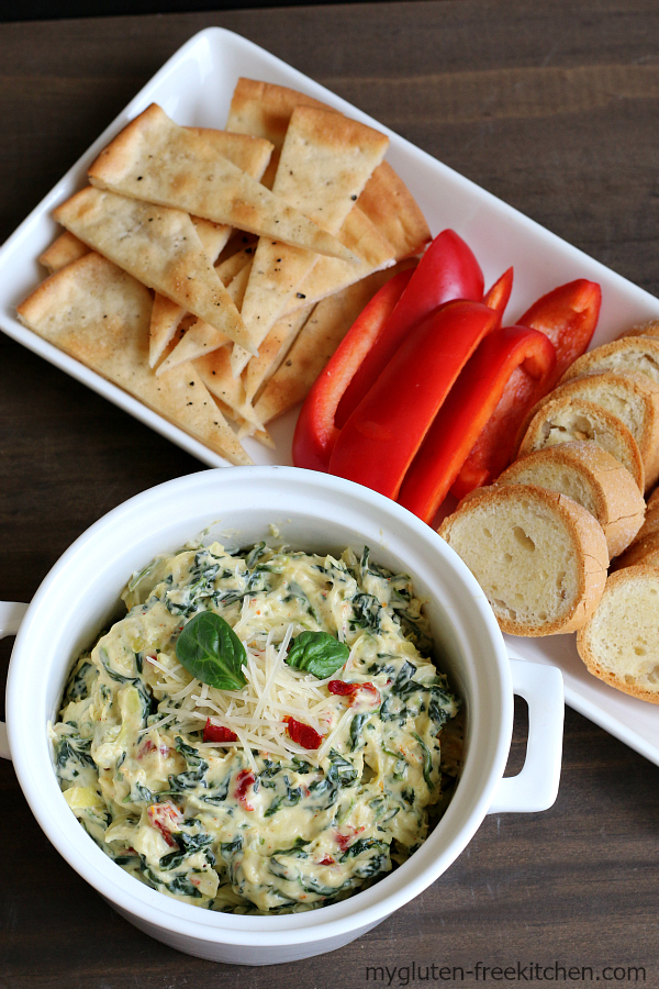 Stovetop Spinach Artichoke Dip with gluten-free baguette slices and more ideas for gluten-free dippers. Easy recipe for this popular appetizer!