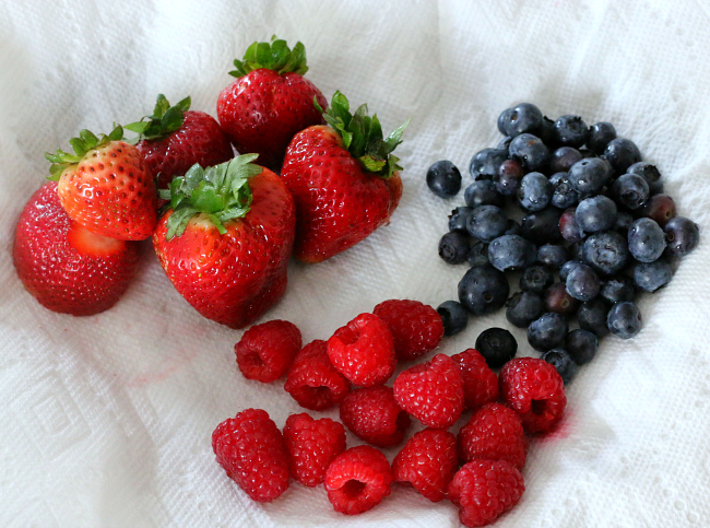 Place washed berries on paper towel to absorb excess water