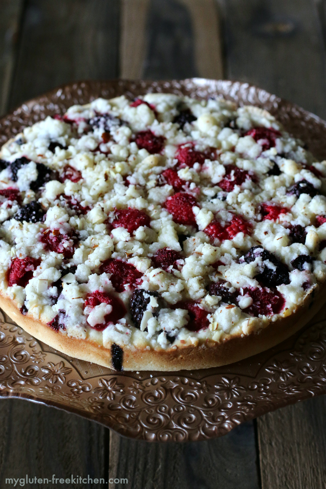 Gluten-free Triple Berry Breakfast Cake Recipe. Can use fresh or frozen berries in this coffee cake.