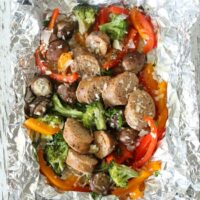 Gluten-free Sausage and vegetable grilled foil packet dinner. Easy option to make dairy-free too. My family loved these because everyone could customize theirs!