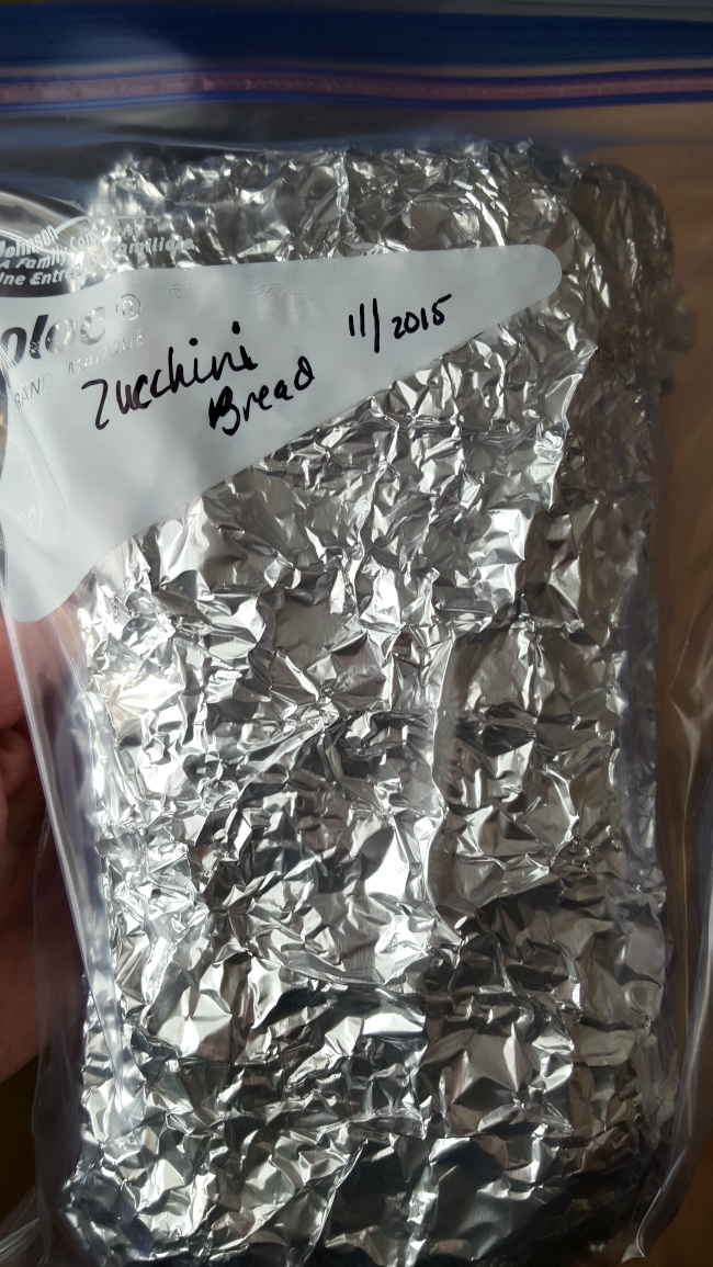 Gluten-free Zucchini Bread wrapped in foil and placed in ziploc bag for freezer
