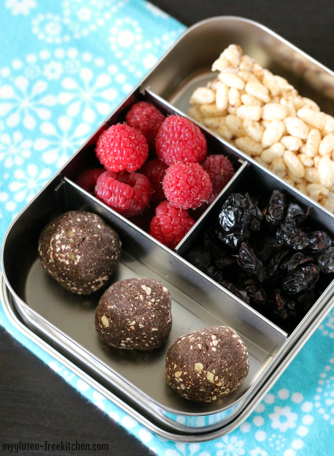 Gluten-free top 8 free snack box with raspberries cranberries rice cake and protein bites