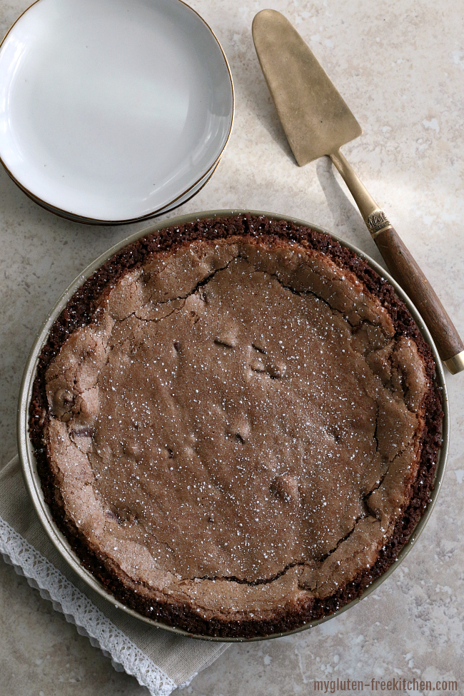 Gluten-free Fudge Pie with Chocolate Crust and powdered sugar sprinkled