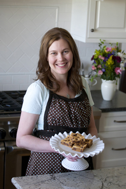 photo of Michelle holding peanut butter brownies on a plate