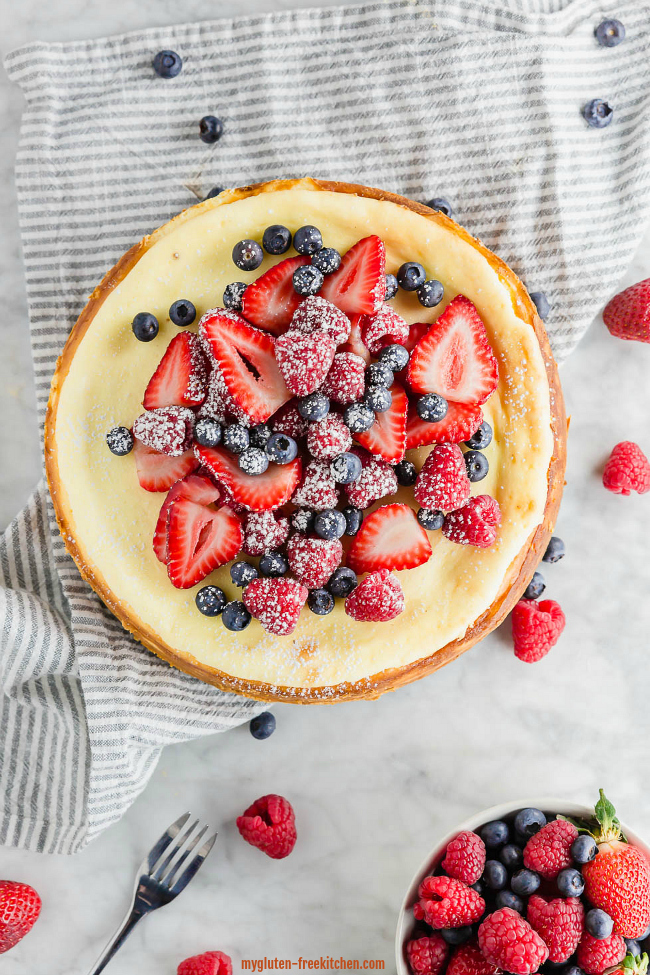 Whole gluten-free cheesecake with berries on top