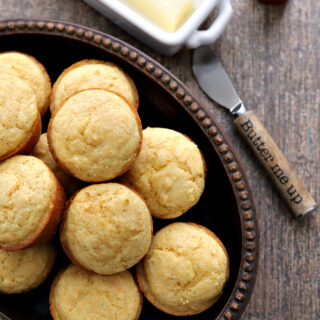Gluten-free Corn Muffins in bowl with knife and butter