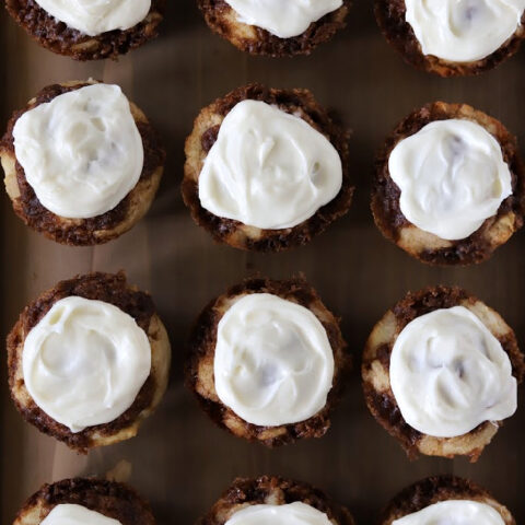 12 gluten-free cinnamon muffins with cream cheese frosting