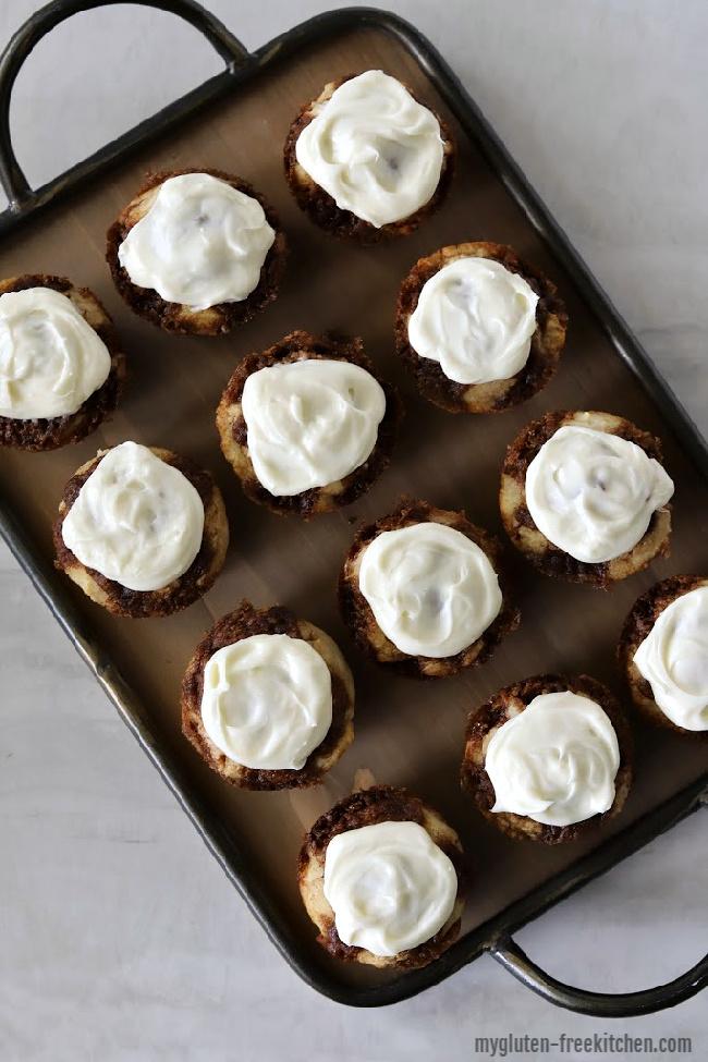 one dozen gluten-free cinnamon roll muffins on platter
