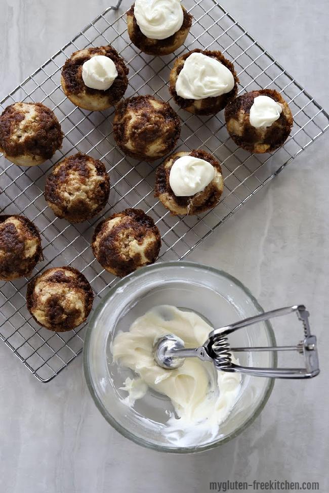 Putting Frosting on gluten-free cinnamon muffins