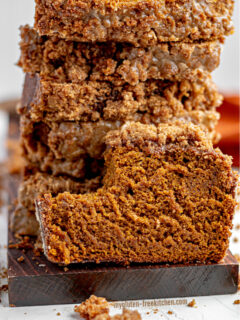 Sliced gluten-free pumpkin bread with bite