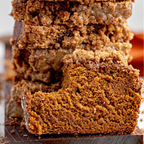 Sliced gluten-free pumpkin bread with bite